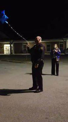 "<div class=""source"">SUBMITTED</div><div class=""image-desc"">Officer John Snellen releases a balloon into the air in honor of Jason Ellis. </div><div class=""buy-pic""></div>"