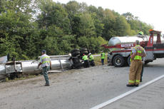 "<div class=""source"">RANDY PATRICK/The Kentucky Standard</div><div class=""image-desc"">Employees of Clean Harbor Environmental offload an oily substance from an overturned tanker on the Bluegrass Parkway Wednesday morning.</div><div class=""buy-pic""><a href=""/photo_select/69481"">Buy this photo</a></div>"