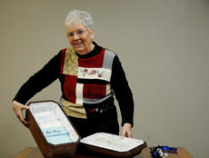 """<div class=""""source"""">JAMES CALVERT/The Kentucky Standard</div><div class=""""image-desc"""">Lucille Abell, Bardstown makes caskets for animals and her clients are mostly dog owners. Lucille said her caskets have become popular among dog owners who want to bury their animal in a sturdy casket, rather than a shoebox. Abell displays one of the polyurethane caskets.  The caskets are more rigid and provide an airtight seal. Abell decorates the interiors of the caskets for pet owners. </div><div class=""""buy-pic""""><a href=""""/photo_select/34047"""">Buy this photo</a></div>"""
