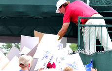 """<div class=""""source"""">DENNIS GEORGE/Contributing Photographer</div><div class=""""image-desc"""">Fan favorite Phil Mickelson signed autographs after completing his practice round Tuesday at Valhalla.</div><div class=""""buy-pic""""></div>"""