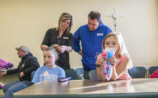 """<div class=""""source"""">KACIE GOODE/The Kentucky Standard</div><div class=""""image-desc"""">Stylist Whitney Parkerson shows Brent Long how to create a messy bun during a Daddy/Daughter hair class at the library Wednesday with 6-year-old Kate, right. Modeling the do was Parkerson's little sister Molly.</div><div class=""""buy-pic""""><a href=""""/photo_select/84184"""">Buy this photo</a></div>"""