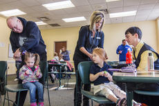 """<div class=""""source"""">KACIE GOODE/The Kentucky Standard</div><div class=""""image-desc"""">Brian Burba, left, practices pigtails on his 2-year-old granddaughter Lily while hair stylist Whitney Parkerson demonstrates an easy braid during a Daddy/Daughter Hair Class at the library Wednesday.</div><div class=""""buy-pic""""><a href=""""/photo_select/84186"""">Buy this photo</a></div>"""