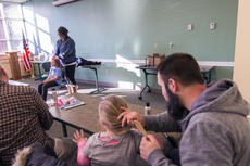 """<div class=""""source"""">KACIE GOODE/The Kentucky Standard</div><div class=""""image-desc"""">Dads follow a demonstration by stylist Ellie Hurst on making a tight ponytail Wednesday during a Daddy/Daughter Hair Class at the Nelson County Public Library.</div><div class=""""buy-pic""""><a href=""""/photo_select/84187"""">Buy this photo</a></div>"""