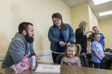 """<div class=""""source"""">KACIE GOODE/The Kentucky Standard</div><div class=""""image-desc"""">Stylist Ellie Hurst shows a dad how to create a tight, but comfortable pigtail Wednesday during a Daddy/Daughter hair class at the library.</div><div class=""""buy-pic""""><a href=""""/photo_select/84190"""">Buy this photo</a></div>"""