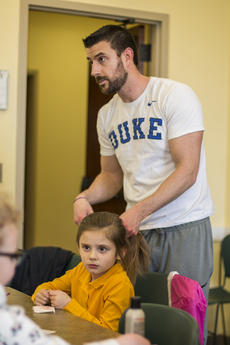 """<div class=""""source"""">KACIE GOODE/The Kentucky Standard</div><div class=""""image-desc"""">Joey Schat works to follow along with a demonstration during a daddy/daughter hair class he attended Wednesday with 5-year-old daughter Avery.</div><div class=""""buy-pic""""><a href=""""/photo_select/84192"""">Buy this photo</a></div>"""