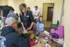 """<div class=""""source"""">KACIE GOODE/The Kentucky Standard</div><div class=""""image-desc"""">Stylist Whitney Parkerson talks about taming curly hair with Nick Redner, who attended a Daddy/Daughter hair class Wednesday with 3-year-old Morgan.</div><div class=""""buy-pic""""><a href=""""/photo_select/84193"""">Buy this photo</a></div>"""