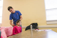 """<div class=""""source"""">KACIE GOODE/The Kentucky Standard</div><div class=""""image-desc"""">Dads practice simple hairstyles during a daddy/daughter class Wednesday at the Nelson County Public Library.</div><div class=""""buy-pic""""><a href=""""/photo_select/84197"""">Buy this photo</a></div>"""