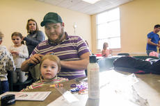 """<div class=""""source"""">KACIE GOODE/The Kentucky Standard</div><div class=""""image-desc"""">Dad Tyler Teske works on a hair style for 2-year-old daughter Kaycee during a Daddy/Daughter Hair Class at the Nelson County Public Library Wednesday.</div><div class=""""buy-pic""""><a href=""""/photo_select/84198"""">Buy this photo</a></div>"""