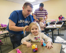 """<div class=""""source"""">KACIE GOODE/The Kentucky Standard</div><div class=""""image-desc"""">Matt Stice works on pigtails for his daughter Audree during a daddy/daughter hair class Wednesday at the Nelson County Public Library.</div><div class=""""buy-pic""""><a href=""""/photo_select/84200"""">Buy this photo</a></div>"""
