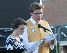 "<div class=""source"">RANDY PATRICK/The Kentucky Standard</div><div class=""image-desc"">Matthew Nalley and Lindsey McGruder read a poem, ""Lily in A7,"" composed by a Bardstown English class as a tribute to Samantha Netherland.</div><div class=""buy-pic""><a href=""http://web2.lcni5.com/cgi-bin/c2newbuyphoto.cgi?pub=191&orig=poetry_reading_1.jpg"" target=""_new"">Buy this photo</a></div>"