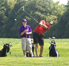 "<div class=""source"">PETER W. ZUBATY/The Kentucky Standard</div><div class=""image-desc"">Nelson County's Parker Taylor tees off in Thursday's Kickin' Chicken Classic at Maywood. Taylor and Bardstown's Logan Brown, left, are their teams' respective No. 1 golfers.</div><div class=""buy-pic""></div>"