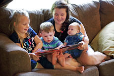 "<div class=""source"">KACIE GOODE/The Kentucky Standard</div><div class=""image-desc"">Courtney Anderson piles on the couch with her sons, Ethan and Eli, and stepdaughter Emily while inside their New Haven Home. The mom of three struggled with pregnancies and never thought she'd be blessed with a growing family, welcoming her youngest son just 8 weeks ago.</div><div class=""buy-pic""></div>"