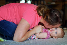 "<div class=""source"">KACIE GOODE/The Kentucky Standard</div><div class=""image-desc"">Ashley Crepps cuddles her 5-month-old daughter, Lucy. She became pregnant with Lucy after suffering a miscarriage.</div><div class=""buy-pic""></div>"