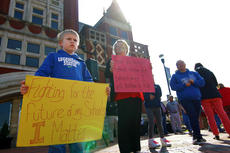 """<div class=""""source"""">KACIE GOODE/The Kentucky Standard</div><div class=""""image-desc"""">Anderson Parrish, a first-grader at Cox's Creek Elementary School, holds a sign during a rally Wednesday in Downtown Bardstown.</div><div class=""""buy-pic""""><a href=""""/photo_select/94393"""">Buy this photo</a></div>"""