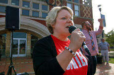 """<div class=""""source"""">KACIE GOODE/The Kentucky Standard</div><div class=""""image-desc"""">Tiffany Parrish, a teacher with Nelson County High School, leads a chant Wednesday during a rally for public education on Court Square in Bardstown.</div><div class=""""buy-pic""""><a href=""""/photo_select/94392"""">Buy this photo</a></div>"""