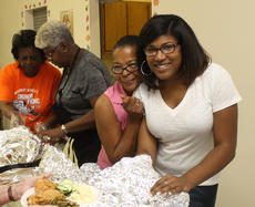 """<div class=""""source"""">RANDY PATRICK/The Kentucky Standard</div><div class=""""image-desc"""">Raven Drake, right, was one of the ladies serving food Saturday at St. Monica Church.</div><div class=""""buy-pic""""><a href=""""/photo_select/89924"""">Buy this photo</a></div>"""