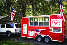 "<div class=""source"">KACIE GOODE/The Kentucky Standard</div><div class=""image-desc"">Red Hearts Concession has a patriotic design. The trailer sits at the family's Bloomfield home when the McDowells are not away at events.</div><div class=""buy-pic""><a href=""/photo_select/79009"">Buy this photo</a></div>"