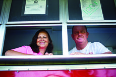 "<div class=""source"">KACIE GOODE/The Kentucky Standard</div><div class=""image-desc"">Wanda and Kenny McDowell lean out the windows of their mobile concession stand, Red Hearts Concession. </div><div class=""buy-pic""><a href=""/photo_select/79010"">Buy this photo</a></div>"