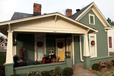 """<div class=""""source"""">SPENCER JENKINS/The Kentucky Standard</div><div class=""""image-desc"""">James and Teri Routt's house at 214 E. John Fitch Ave. sits decorated with ribbons, wreaths, ornamanets and an assortment of colors. The house was built in 1896 and is listed on the National Registry.</div><div class=""""buy-pic""""><a href=""""/photo_select/43278"""">Buy this photo</a></div>"""