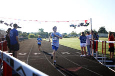 "<div class=""source"">KACIE GOODE/The Kentucky Standard</div><div class=""image-desc"">Alex Fell pushes to the finish line as Sam Mouser follows Monday at a Labor Day race event at Nelson County High School.</div><div class=""buy-pic""><a href=""/photo_select/79276"">Buy this photo</a></div>"
