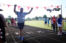 "<div class=""source"">KACIE GOODE/The Kentucky Standard</div><div class=""image-desc"">David Brown crosses the finish line Monday at the annual Labor Day race event at Nelson County High School.</div><div class=""buy-pic""><a href=""/photo_select/79278"">Buy this photo</a></div>"