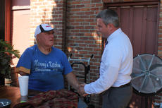 """<div class=""""source"""">RANDY PATRICK/The Kentucky Standard</div><div class=""""image-desc"""">Ryan Quarles, Republican candidate for agriculture commissioner, asks Walt Frasier for his vote at Mammy's Kitchen last week.</div><div class=""""buy-pic""""><a href=""""/photo_select/69590"""">Buy this photo</a></div>"""