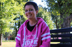 "<div class=""source"">TREY CRUMBIE/The Kentucky Standard</div><div class=""image-desc"">Sasha Molohon-Medley was diagnosed with breast cancer in August after she noticed a lump on her chest in July. Despite the diagnosis, Molohon-Medley maintains a positive attitude and is grateful for her large support group.</div><div class=""buy-pic""><a href=""/photo_select/80228"">Buy this photo</a></div>"