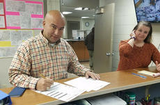 """<div class=""""source"""">PHOTO SUBMITTED</div><div class=""""image-desc"""">Nelson County Deputy Sheriff Sgt. Ramon Pineiroa files paperwork Wednesday morning  at the Nelson County Clerk's office to run for sheriff.</div><div class=""""buy-pic""""><a href=""""/photo_select/90747"""">Buy this photo</a></div>"""