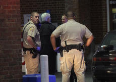 "<div class=""source"">RANDY PATRICK/The Kentucky Standard</div><div class=""image-desc"">Deputy Sheriffs Brandon Bryan, left, and A.J. Lewis, right, arrived on the scene early at the FiveStar downtown just after 12:30 a.m. Monday after there was a report of a gunshot victim. In the center, Deputy Coroner Brian Papenfuss talks with Paramedic Brandon Cissell.</div><div class=""buy-pic""><a href=""/photo_select/85795"">Buy this photo</a></div>"