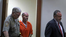"<div class=""source"">KACIE GOODE/The Kentucky Standard</div><div class=""image-desc"">Deputy Mike Boone escorts Danny Singleton and council into the courtroom Thursday afternoon.</div><div class=""buy-pic""><a href=""/photo_select/74123"">Buy this photo</a></div>"