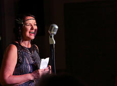 "<div class=""source"">KACIE GOODE/The Kentucky Standard</div><div class=""image-desc"">Dala Utley welcomes guests for ""Speakeasy Bourbon Style"" at The Gallery Wednesay night.</div><div class=""buy-pic""><a href=""/photo_select/89224"">Buy this photo</a></div>"