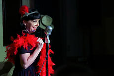 "<div class=""source"">KACIE GOODE/The Kentucky Standard</div><div class=""image-desc"">Ruby (Serena Lear) performs during ""Speakeasy Bourbon Style,"" a play by Toni Wiley, at the Bardstown for the Arts/The Gallery on Court Square Wednesday night.</div><div class=""buy-pic""><a href=""/photo_select/89235"">Buy this photo</a></div>"