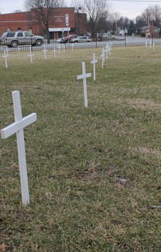 """<div class=""""source"""">RANDY PATRICK/The Kentucky Standard</div><div class=""""image-desc"""">Scores of white crosses on the lawn of the Basilica of St. Joseph Proto Cathedral are a reminder of the more than 50 million abortions since the U.S. Supreme Court's Roe v. Wade decision on Jan. 22, 1973. The crosses were made and are placed on the lawn every year by members of the Respect for Life Committee.</div><div class=""""buy-pic""""><a href=""""/photo_select/63175"""">Buy this photo</a></div>"""