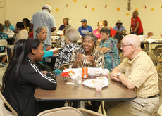 """<div class=""""source"""">RANDY PATRICK/The Kentucky Standard</div><div class=""""image-desc"""">Kyesha Hamilton, Ellen Lydian and Rin Saginario enjoy conversation after supper Saturday at the St. Monica Church Fall Festival. </div><div class=""""buy-pic""""><a href=""""/photo_select/89920"""">Buy this photo</a></div>"""