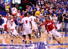 "<div class=""source"">Peter W. Zubaty</div><div class=""image-desc"">Pandemonium breaks out after Madison Central's come-from-behind 65-64 win over Ballard in the first-ever Sunday playing of the KHSAA Sweet 16 championship. Under the old format, which featured the semifinals on Saturday morning and finals on Saturday night, the Indians may not have had the gas left in the tank to rally from 16 points down.</div><div class=""buy-pic""></div>"