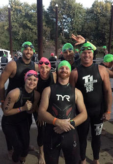 "<div class=""source"">Submitted Photo </div><div class=""image-desc"">A recent Louisville triathlon proved to be a challenge for several local participants, who spent months training for one of the most physically taxing events around.  Elliot Mattingly, Liz Mattingly, Amanda Mattingly, Brett Martin, Kyle Newton and Dale Hill take a group photo during the swim portion of Ironman in Louisville.  </div><div class=""buy-pic""></div>"