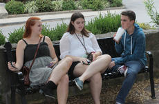 """<div class=""""source"""">RANDY PATRICK/The Kentucky Standard</div><div class=""""image-desc"""">Friends Elizabeth Montgomery, Katie Berg and Benjamin Carter hang out in front of the Gallery on the Square Saturday. </div><div class=""""buy-pic""""><a href=""""/photo_select/89927"""">Buy this photo</a></div>"""