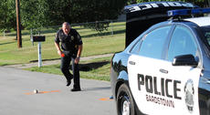 """<div class=""""source"""">RANDY PATRICK/The Kentucky Standard</div><div class=""""image-desc"""">Bardstown Police Officer Tom Blair marks the location of a pair of child's shoes on the pavement with spray paint in front of 4009 Dixie Lane Monday evening, where a child was struck by a vehicle.</div><div class=""""buy-pic""""><a href=""""/photo_select/66911"""">Buy this photo</a></div>"""