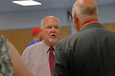 """<div class=""""source"""">KACIE GOODE/The Kentucky Standard</div><div class=""""image-desc"""">Tom Brown speaks with board members following a special-called meeting Saturday morning for Nelson County Schools. Brown has been selected as acting superintendent for the district.</div><div class=""""buy-pic""""><a href=""""/photo_select/87753"""">Buy this photo</a></div>"""