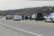 "<div class=""source"">RANDY PATRICK/The Kentucky Standard</div><div class=""image-desc"">Traffic was able to get through on Louisville Road (U.S. 31E) in Mount Washington after a police chase ended in a collision between the Yukon and two cop cars and impact with a guardrail.</div><div class=""buy-pic""><a href=""/photo_select/84031"">Buy this photo</a></div>"