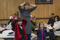 "<div class=""source"">KACIE GOODE/The Kentucky Standard</div><div class=""image-desc"">Families play Heads or Tails in between rounds of a trivia night fundraiser Friday at American Legion Post 121. The event raised money to fund a potential film project about a local Vietnam unit.</div><div class=""buy-pic""><a href=""/photo_select/83103"">Buy this photo</a></div>"