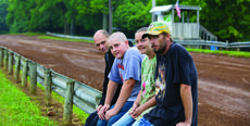 "<div class=""source"">FORREST BERKSHIRE/The Kentucky Standard</div><div class=""image-desc"">They showed up for the truck and tractor pull at Friday night's Nelson County Fair only to find the event canceled because the track was too wet. Sitting beside the track are, from right, John Chesser, Jamie Beals, William Harrington and Buechel Adams, all of Bardstown.</div><div class=""buy-pic""><a href=""/photo_select/58215"">Buy this photo</a></div>"