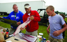 "<div class=""source"">FORREST BERKSHIRE/The Kentucky Standard</div><div class=""image-desc"">From left, Dennis Folz, Jonathan Cook and Dalton Folz prepare a tenderloin for the grill. The group from Hopkinsville had planned on entering the truck and tractor pull Friday night at the Nelson County Fair, but the event was canceled because of rain. But the group was still determined to enjoy the cook out they had planned.</div><div class=""buy-pic""><a href=""http://web2.lcni5.com/cgi-bin/c2newbuyphoto.cgi?pub=191&orig=truck_pull_002new.jpg"" target=""_new"">Buy this photo</a></div>"