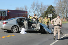 """<div class=""""source"""">RANDY PATRICK/The Kentucky Standard</div><div class=""""image-desc"""">A 19-year-old man was transported to the University of Louisville Hospital after a two-car collision about 10 a.m. Saturday at the intersection of Springfield Road (U.S. 150) and Manton. According to Nelson County deputies, the driver of the Lexus who was hurt pulled out onto Springfield in front of a Ford F-250 going east. Both vehicles sustained heavy front-end damage, but the young man driving the truck and his female passenger were not hurt. Deputies weren't able to provide the names of the people involved at the time. Nelson County EMS transported the patient and Nelson County Fire and Rescue assisted.</div><div class=""""buy-pic""""><a href=""""/photo_select/93466"""">Buy this photo</a></div>"""