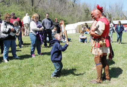 A brave little warrior, Madix Bills, 4, of Fort Knox, attacks a Cherokee, played by Terrell Bryant of Clermont, with his wooden sword.