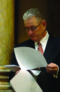 Sen. Jimmy Higdon, R-Lebanon, studies legislation in the Kentucky Senate last week, during the opening week of the 2014 Regular Session of the Kentucky General Assembly.