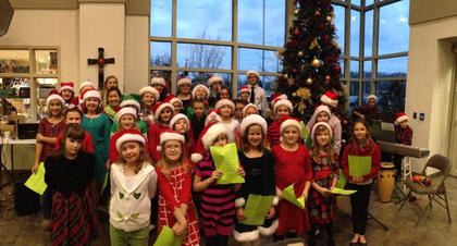 St. Joseph Grade and Middle School Choirs sang at Flaget Memorial Hospital's Christmas tree lighting ceremony last month.
