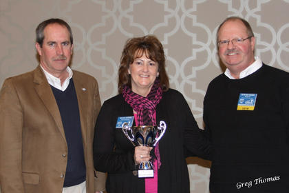Steve Kelley, Kentucky Department of Agriculture, Beckie  Downs, Nelson County Fair Board (in charge of book) and president of Kafhs,  Howard  Moore at  convention  at the  Galt  House  Jan 18  in  Louisville. Beckie  accepts the award for  best newspaper print in the book.