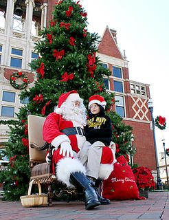 Ryan Jerome, 6, Bardstown, visits with Santa Claus in front of the Old Courthouse in Bardstown on Saturday.