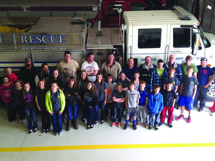 The New Haven Community Youth Club organized a community service project Saturday that included cooked chili to feed fire fighters while they took part in an all-day training exercise.